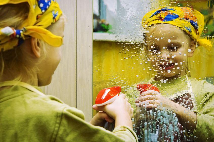 little girl cleans window